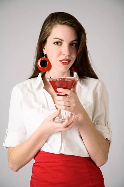 mädchen holding glas of cherries-englische redewendung - rote bleistiftröcke stock-fotos und bilder
