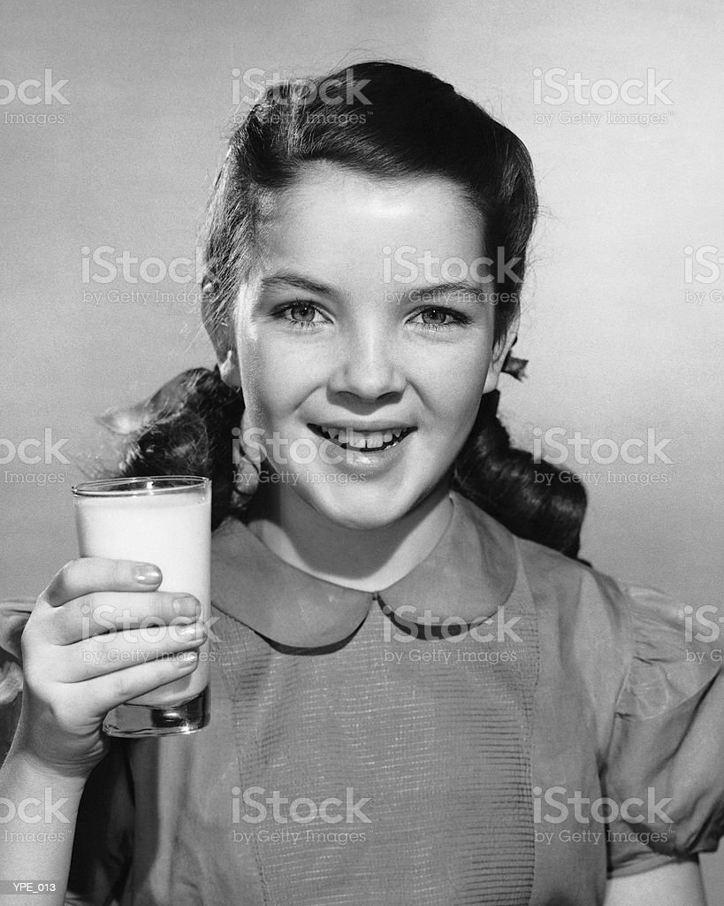 Girl holding glass of milk 免版稅 stock photo