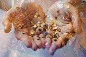 Girl holding gold star confetti