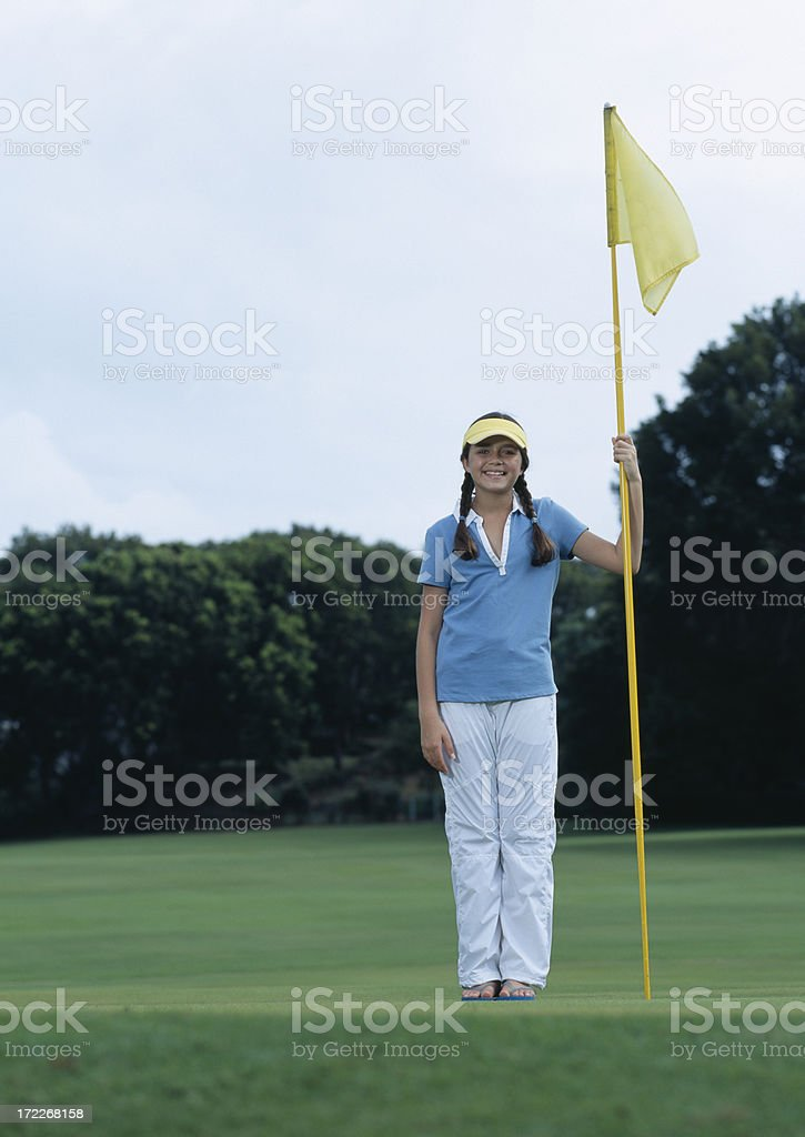 Girl holding golf flag royalty-free stock photo