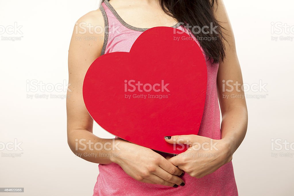 Girl holding heart with candy stock photo