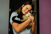 istock Girl holding her cat and cuddling. 1257362574