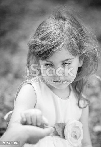 Girl holding her mother's hand black&white