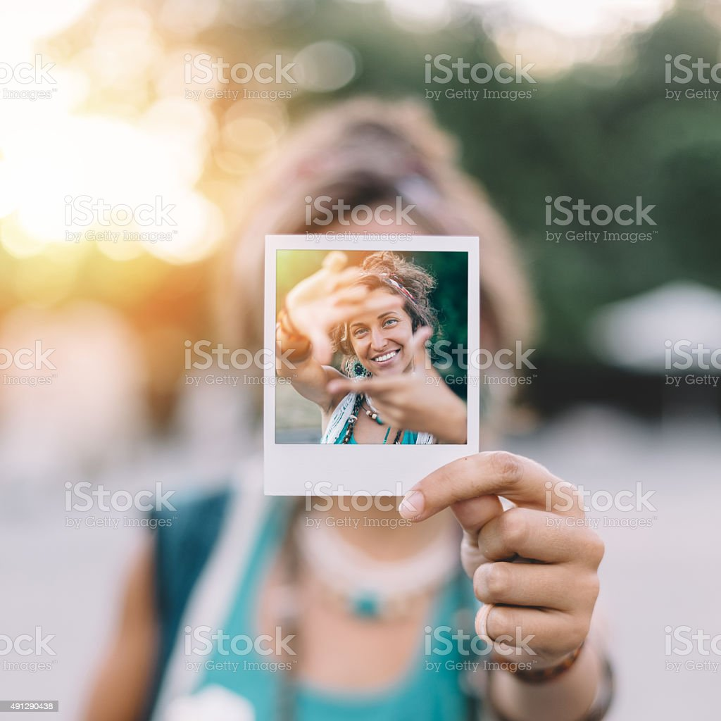 Girl holding instant selfie stock photo