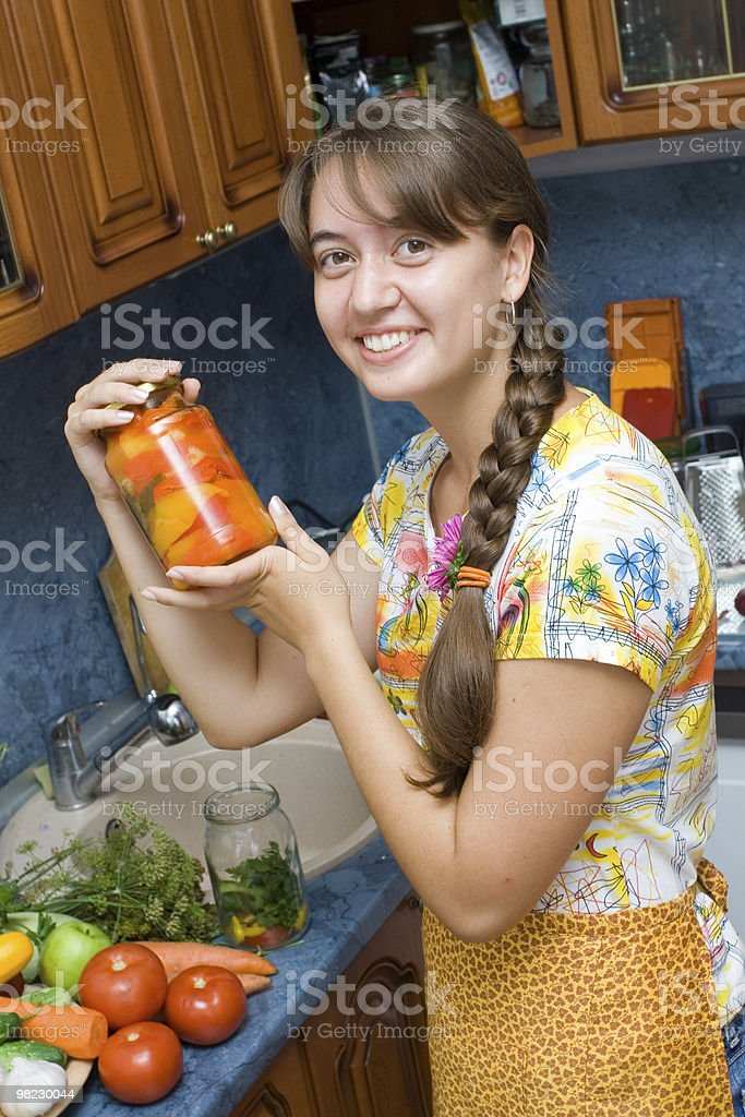 Girl holding jar with vegetables royalty-free stock photo