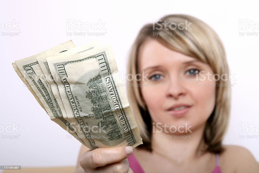 Girl holding money royalty-free stock photo