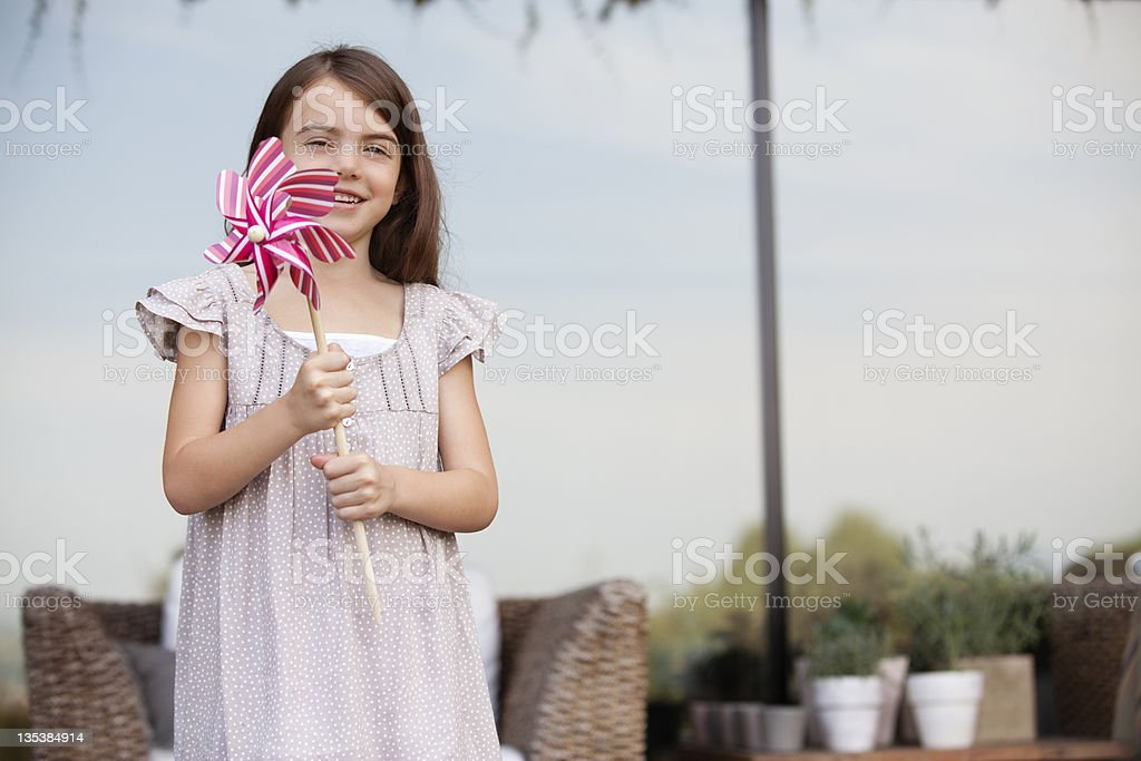 Girl holding pinwheel outdoors royalty-free stock photo