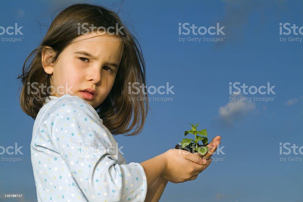 girl holding plant royalty-free stock photo