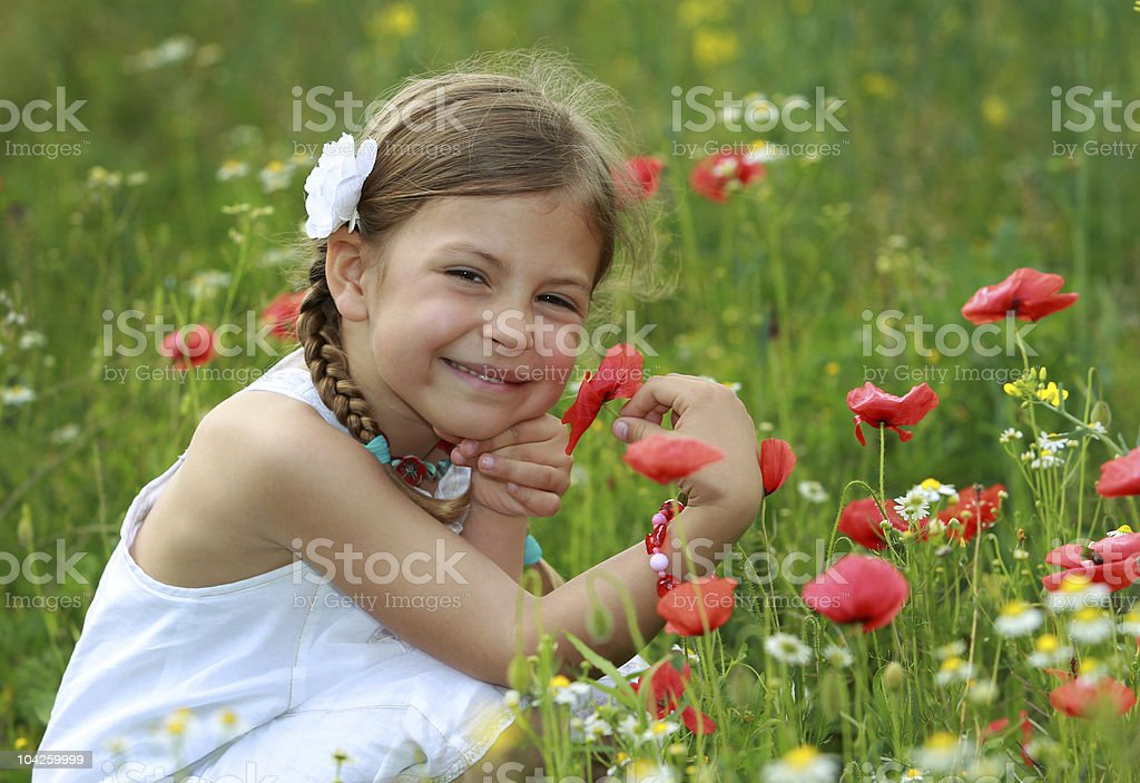 Girl holding poppy royalty-free stock photo