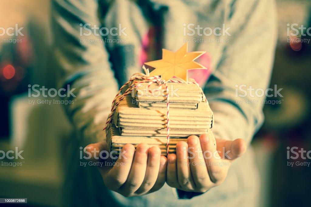 Girl holding present stock photo