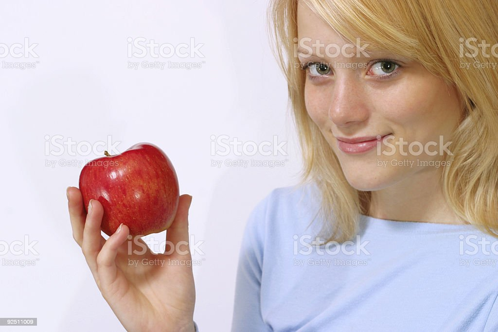 Girl holding red apple royalty-free stock photo