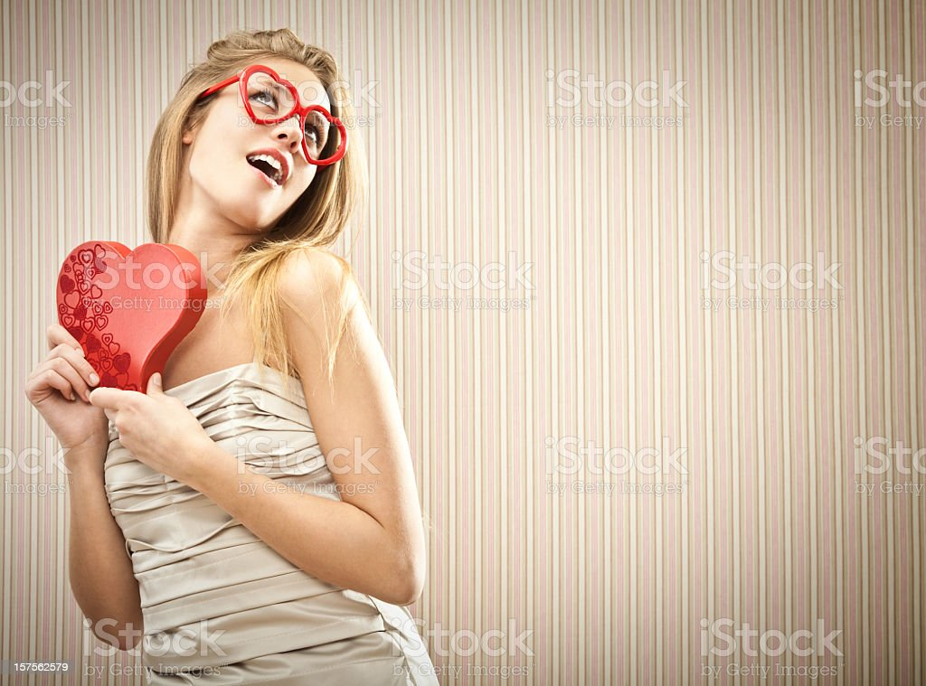 Girl holding red heart and heart glasses royalty-free stock photo