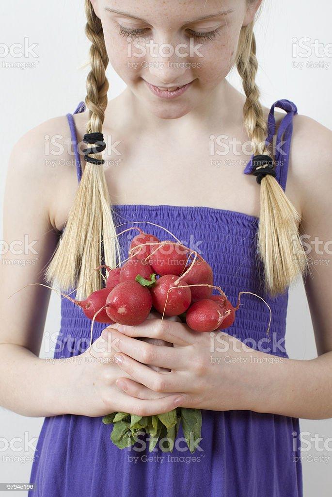 Girl holding red radish bunch royalty-free stock photo