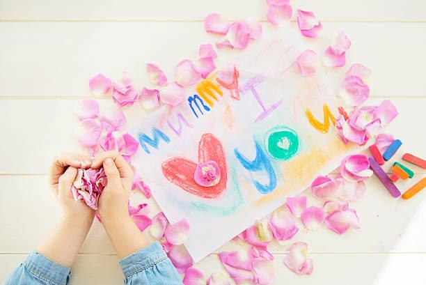 Girl holding rose petals with drawing for mummy picture id466012126?b=1&k=6&m=466012126&s=612x612&w=0&h=c4vh2qcrxb3uqibcdpiovqctm1qe5uivczorl9x c 4=