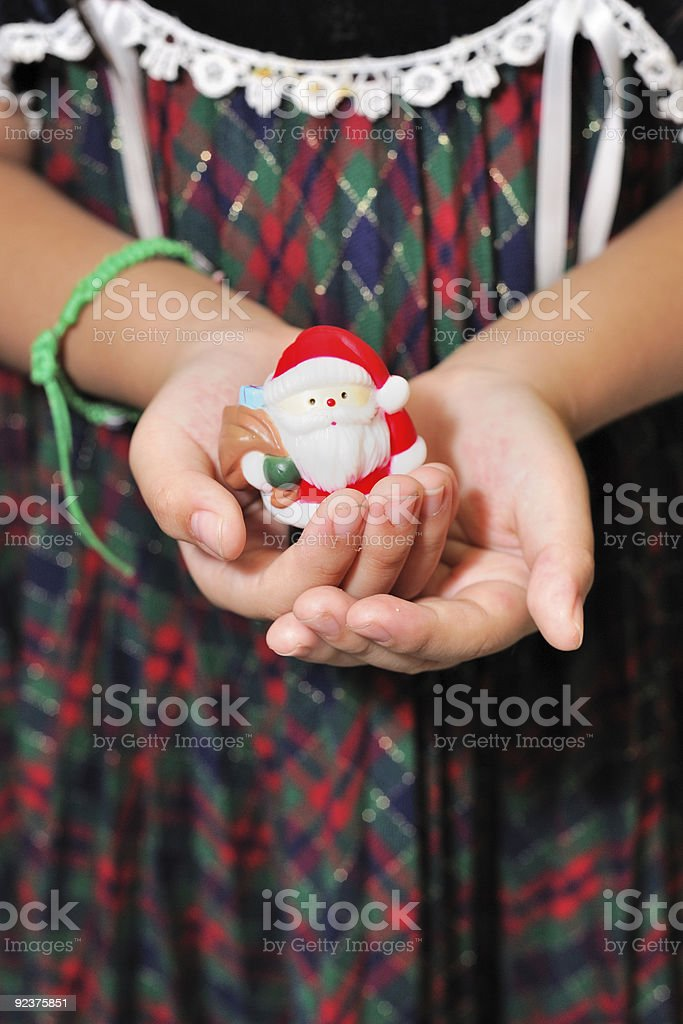 Girl holding Santa Claus toy royalty-free stock photo