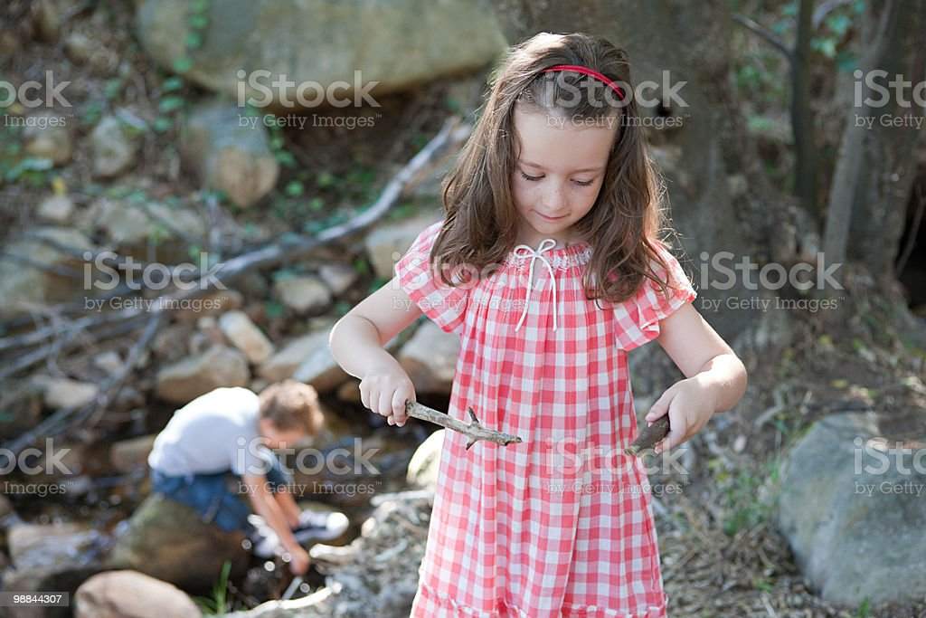 Girl holding sticks royalty-free stock photo