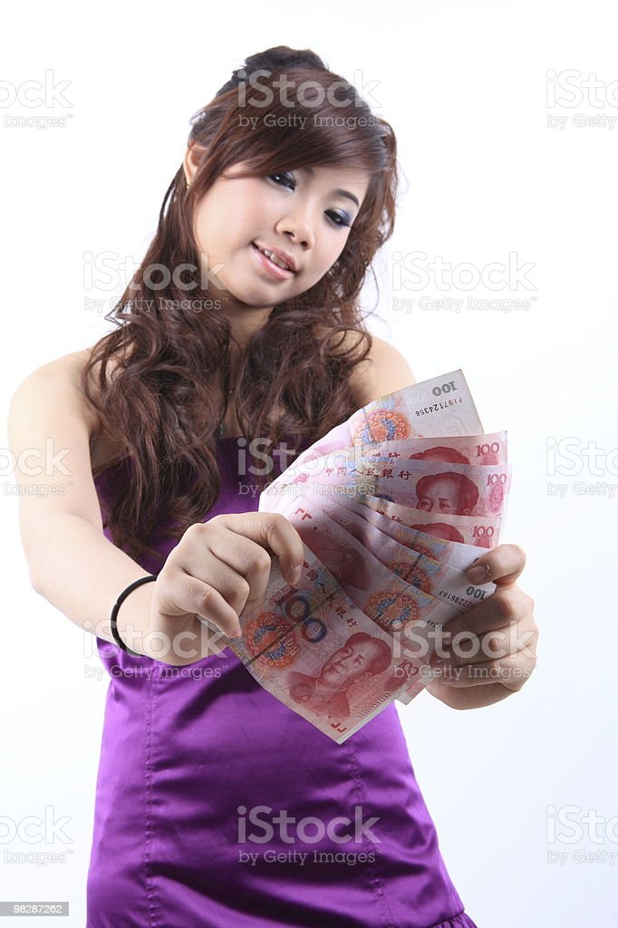 Girl holding the RMB royalty-free stock photo