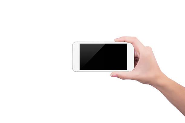 Mädchen holding der weißen Telefon aufrecht in der rechten hand – Foto