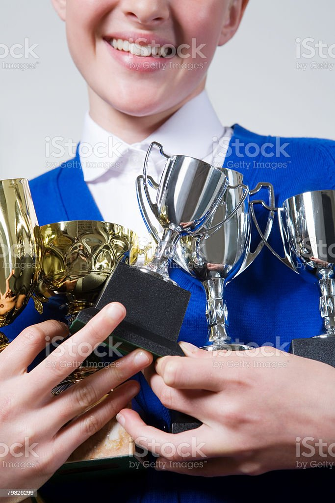 Girl holding trophies foto de stock royalty-free