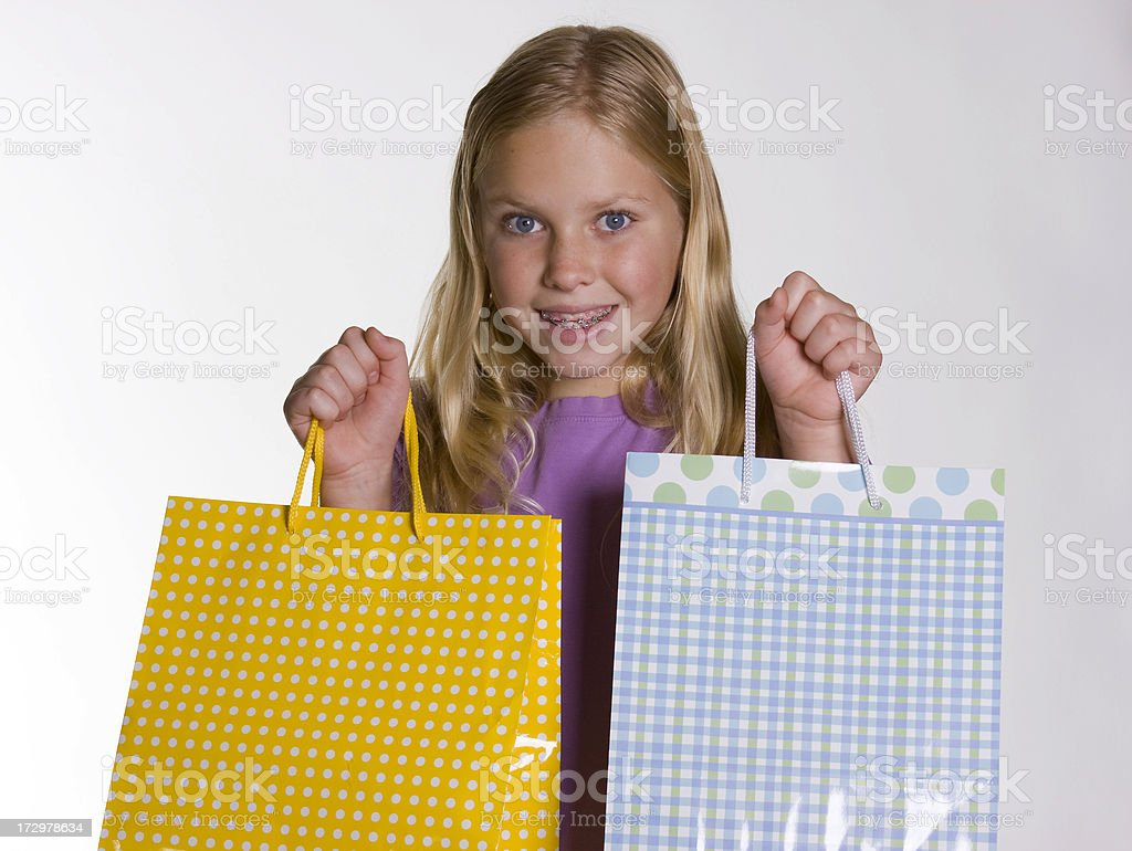 Girl Holding Two Bags stock photo