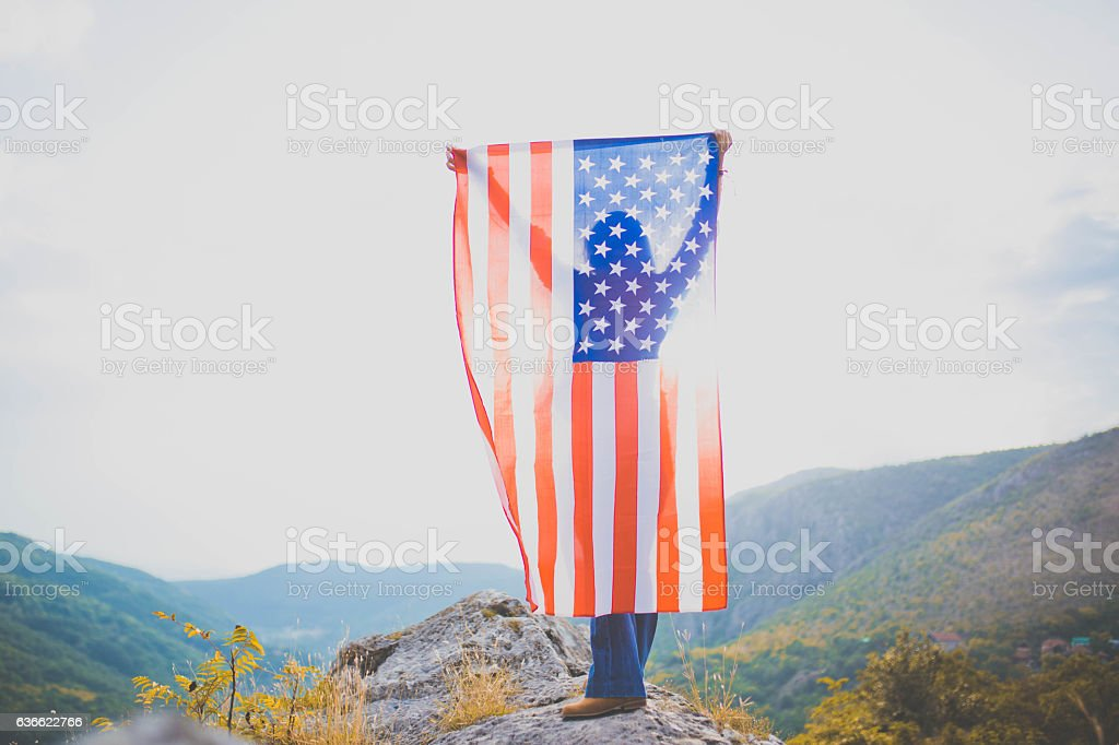 Girl holding US flag stock photo