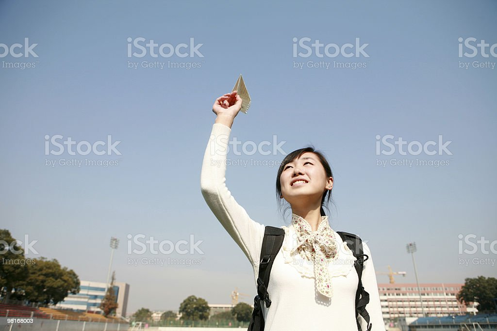 girl holding with paper airplane royalty-free stock photo