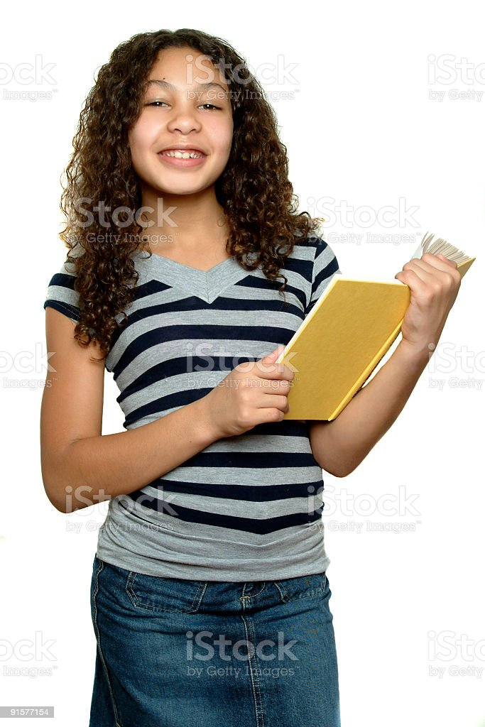 Girl holding yellow book smiling and looking at camera royalty-free stock photo