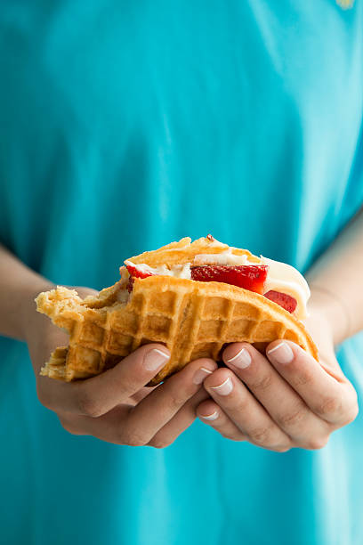 girl holds delicious waffle stock photo