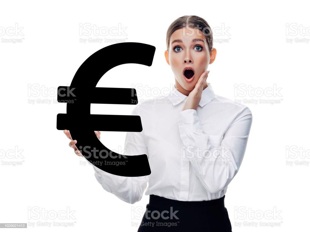 Girl holds euro symbol stock photo
