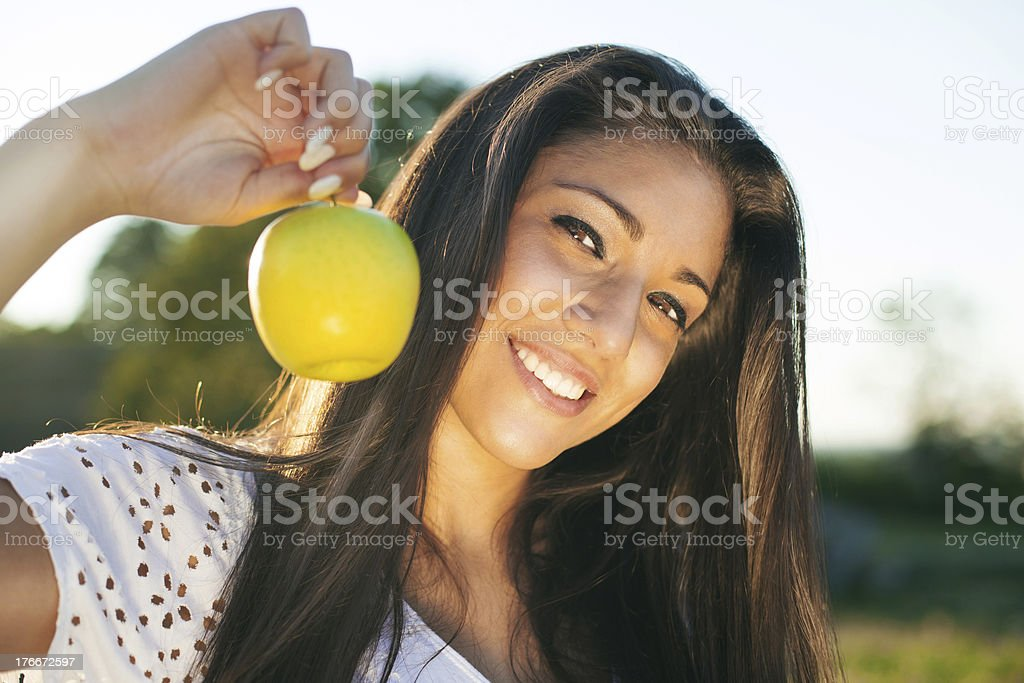 Girl holds green apple royalty-free stock photo