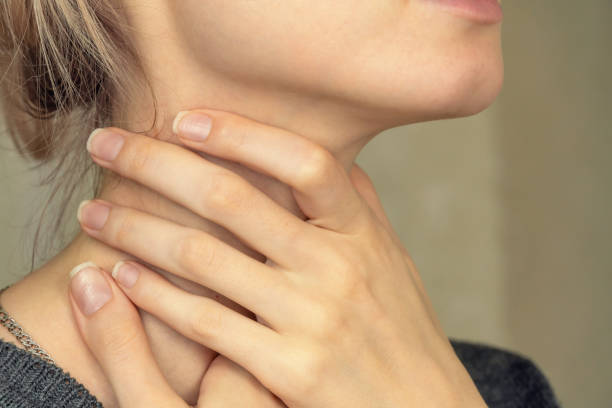 Girl holds her hands to her throat, sore throat. Close-up of the girl's hands touching the sore throat. Girl holds her hands to her throat, sore throat. Close-up of the girl's hands touching the sore throat. heartburn throat pain stock pictures, royalty-free photos & images