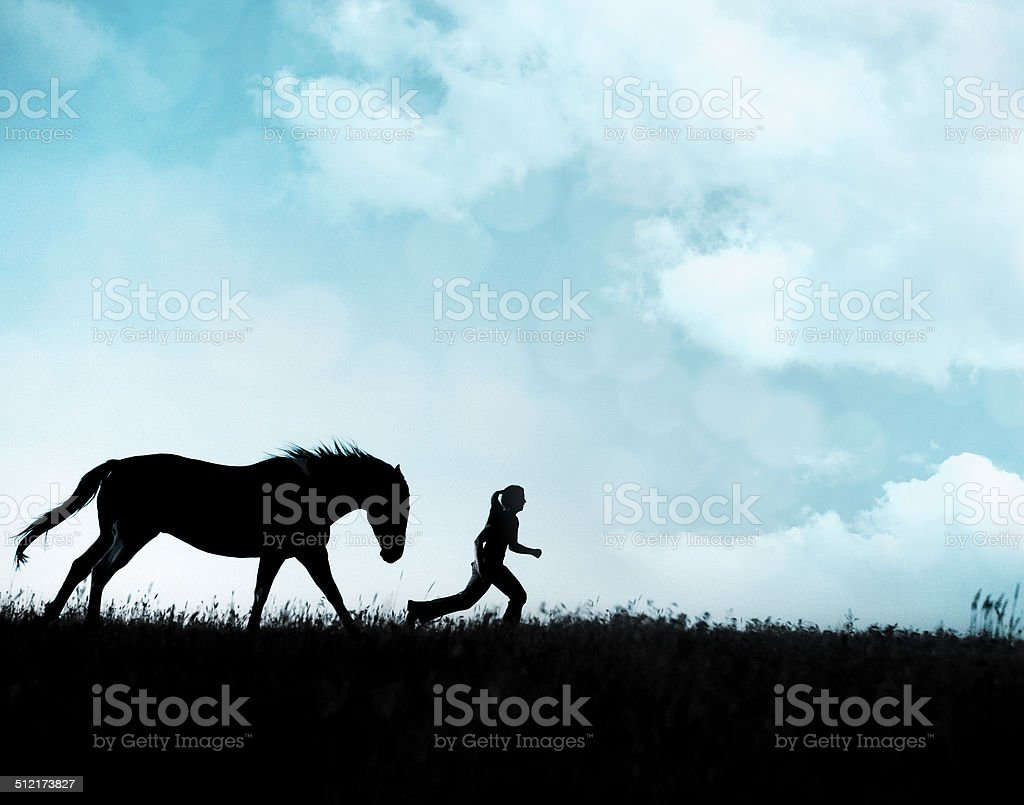 Girl & Horse Running Together stock photo