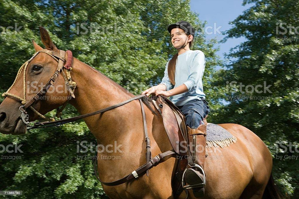 Girl horseback riding royalty-free stock photo