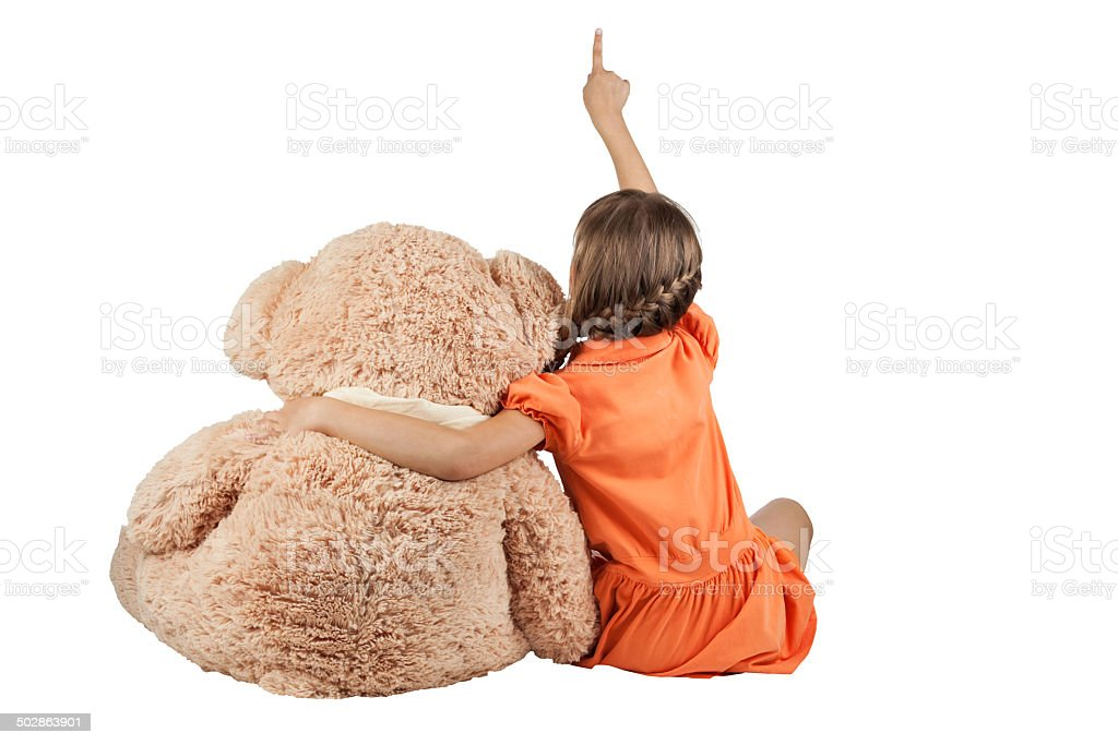 Girl hugging bears and shows thumb up stock photo