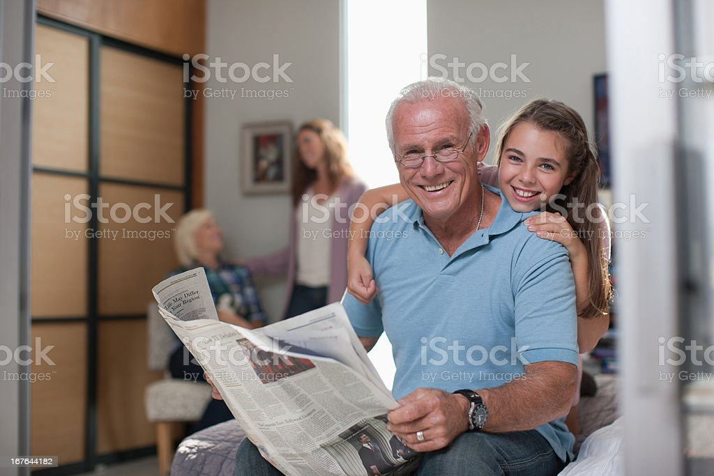 Girl hugging grandfather at home royalty-free stock photo