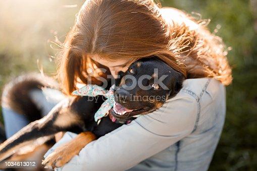 istock Girl hugging her dog 1034613012