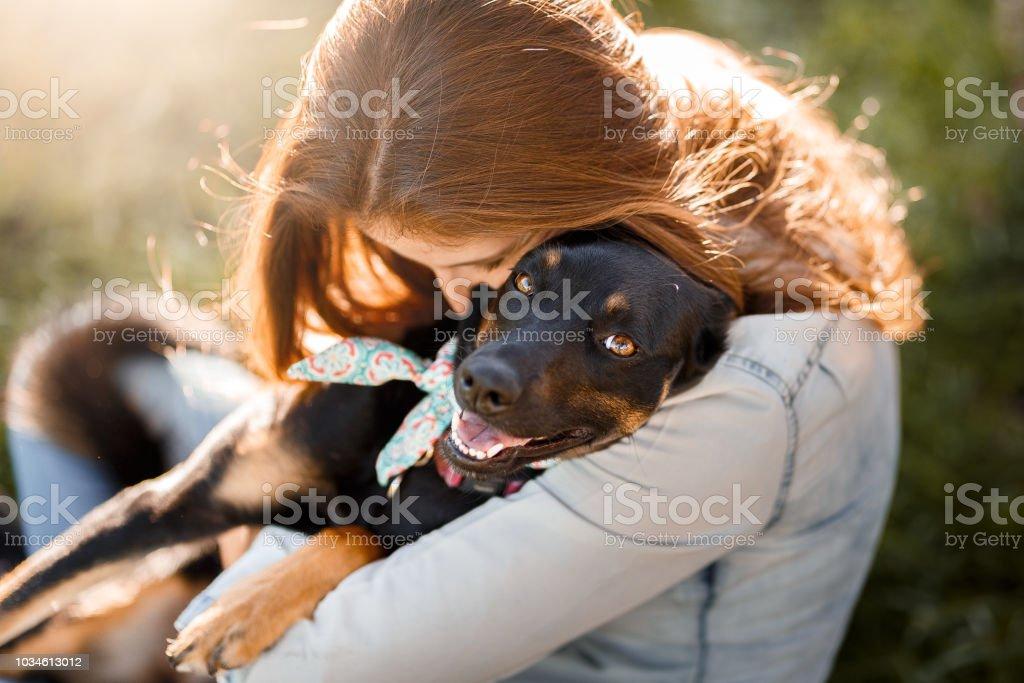 Girl hugging her dog stock photo