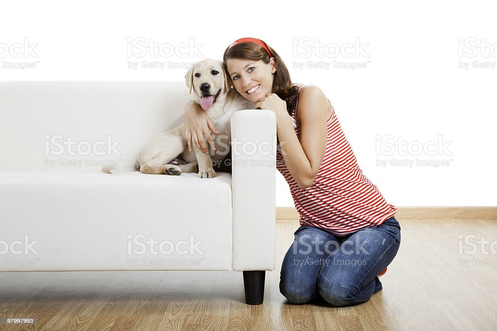 Girl hugging her dog that's on the couch royalty free stockfoto