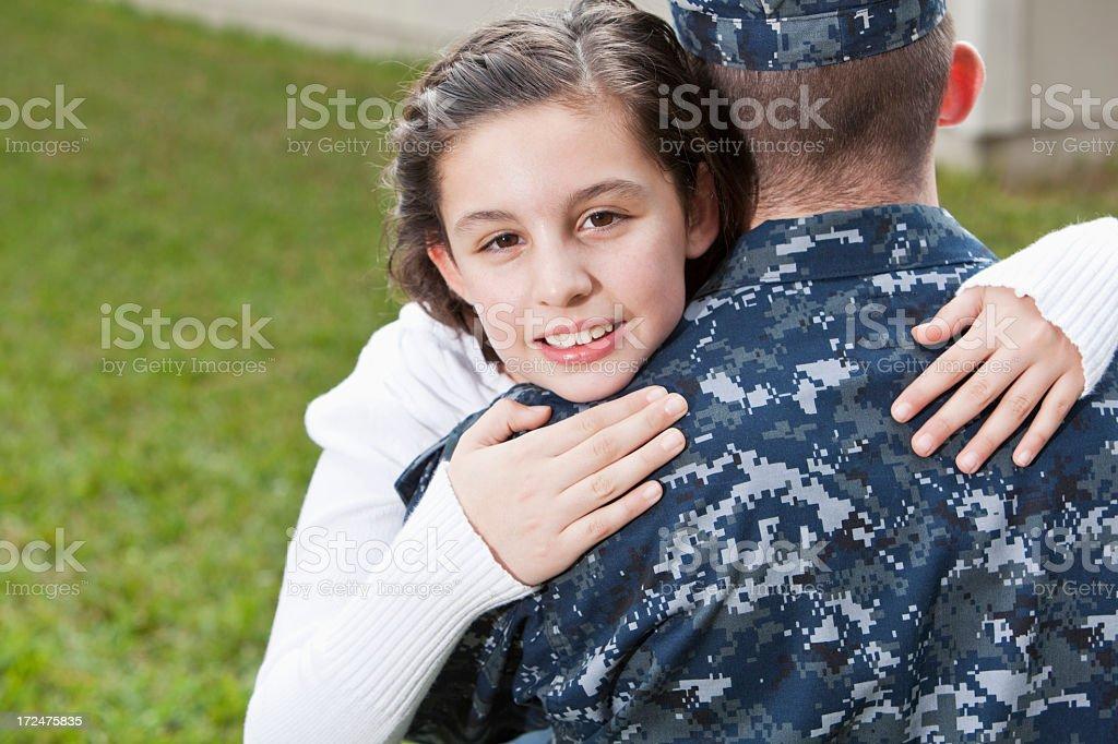 Girl hugging military dad royalty-free stock photo