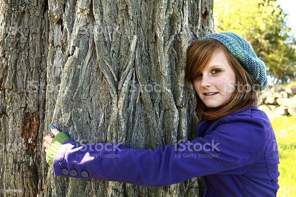 Girl Hugging Tree royalty-free stock photo