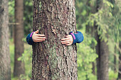 Girl hugs a tree