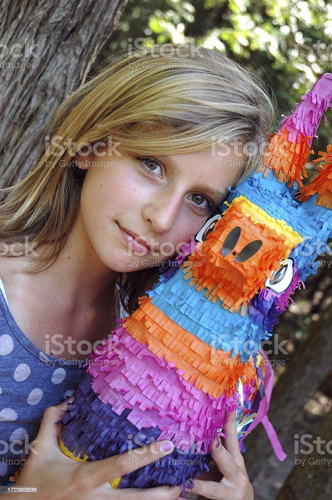 Girl Hugs Pinata royalty-free stock photo