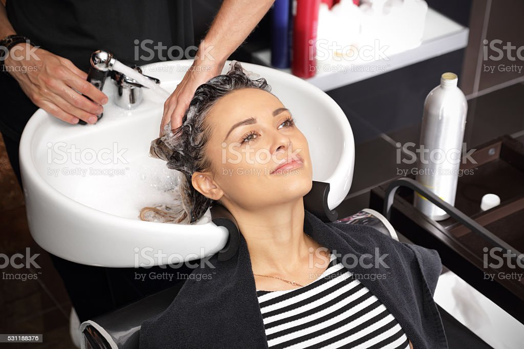 Girl in a beauty salon relaxes stock photo