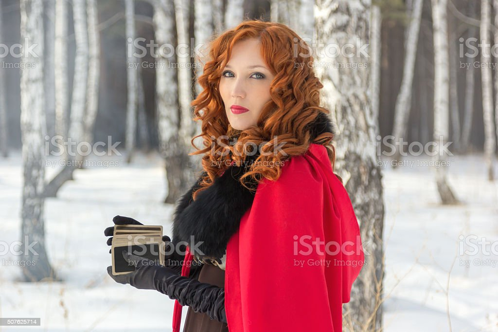 Girl in a birch forest with a deck of cards stock photo