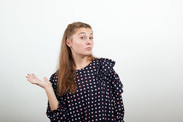 girl in a black dress disappointed negative woman raised her hand in displeasure Fair-haired beautiful girl in a black dress with white circles disappointed negative woman raised her hand in displeasure alas stock pictures, royalty-free photos & images
