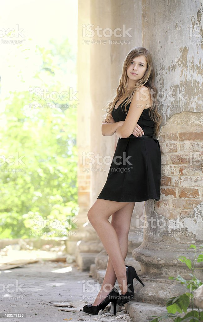 Girl in a black dress. royalty-free stock photo