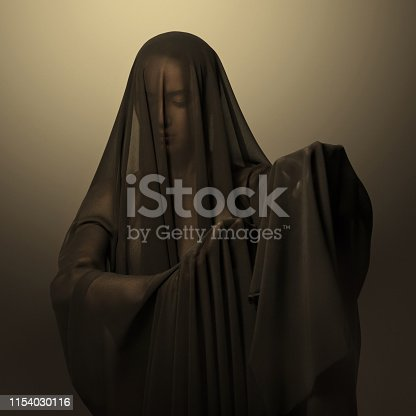 Girl in a black transparent veil on the face. Conceptual portrait in the studio. Minimalism.