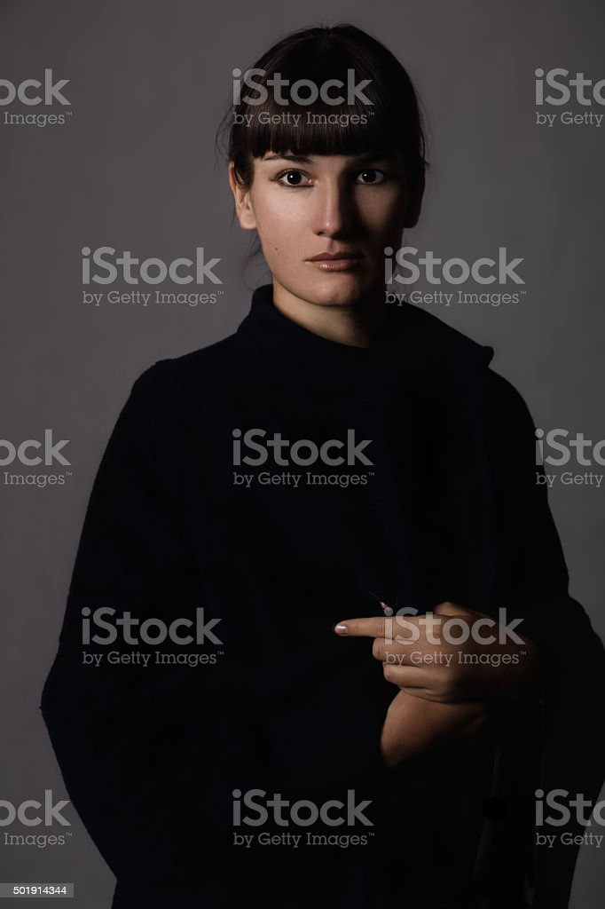 Girl in a blue coat 2 stock photo