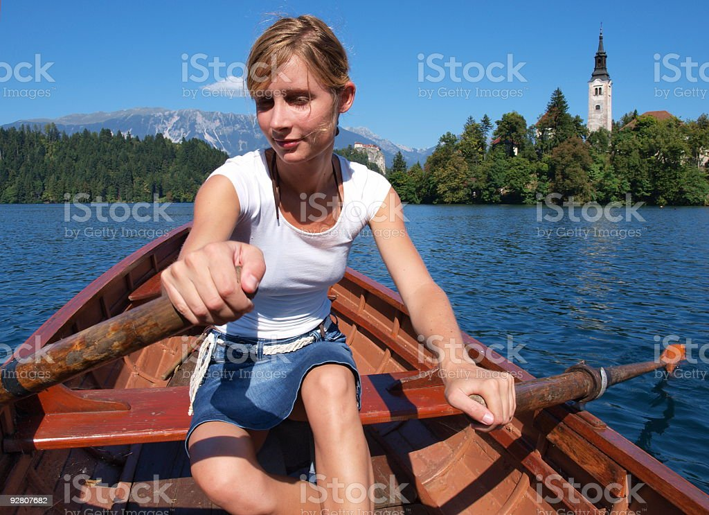 Girl in a boat at lake Bled royalty-free stock photo
