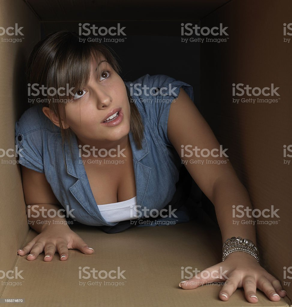 Girl in a box royalty-free stock photo